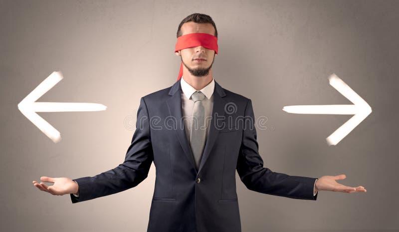 选择方向的被盖的眼睛商人 图库摄影