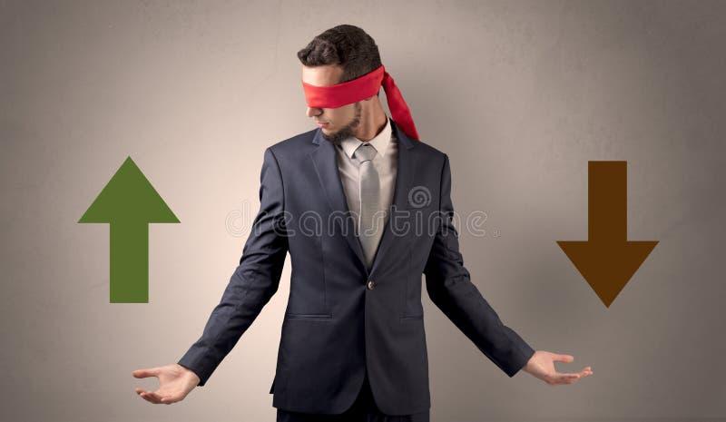 选择方向的被盖的眼睛商人 库存照片