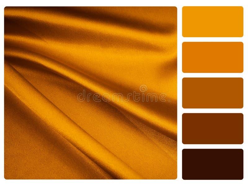 Échantillon de palette de couleur de satin d'or images stock