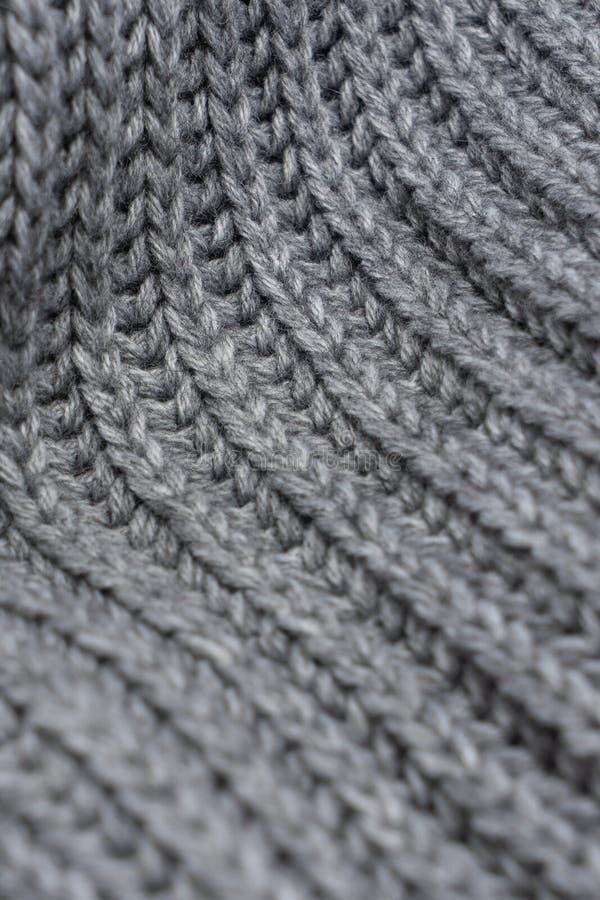 Écharpe tricotée de laine grise Texture de vue de plan rapproché avec le bokeh photographie stock