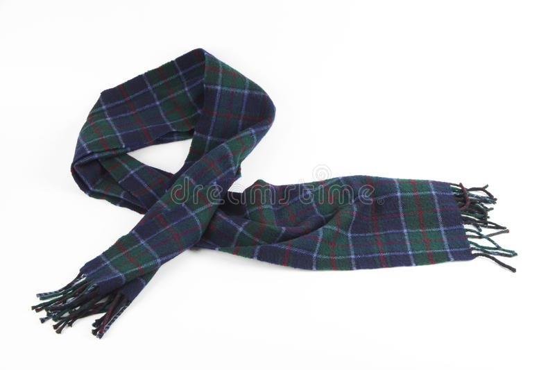 Écharpe verdâtre-bleue chaude de laine sur le fond blanc photo libre de droits