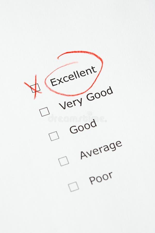 Échelle d'évaluation avec EXCELLENT contrôlé photo stock