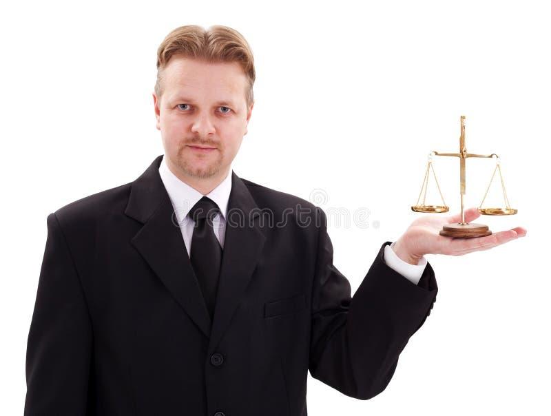 Échelle sérieuse de justice de fixation d'avocat photo stock