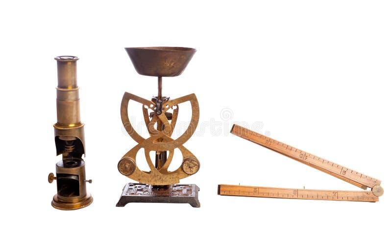 Échelles d'antiquité, échelle, microscope, images stock