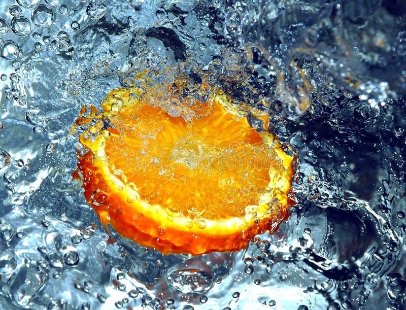 Éclaboussement de l'orange photo stock