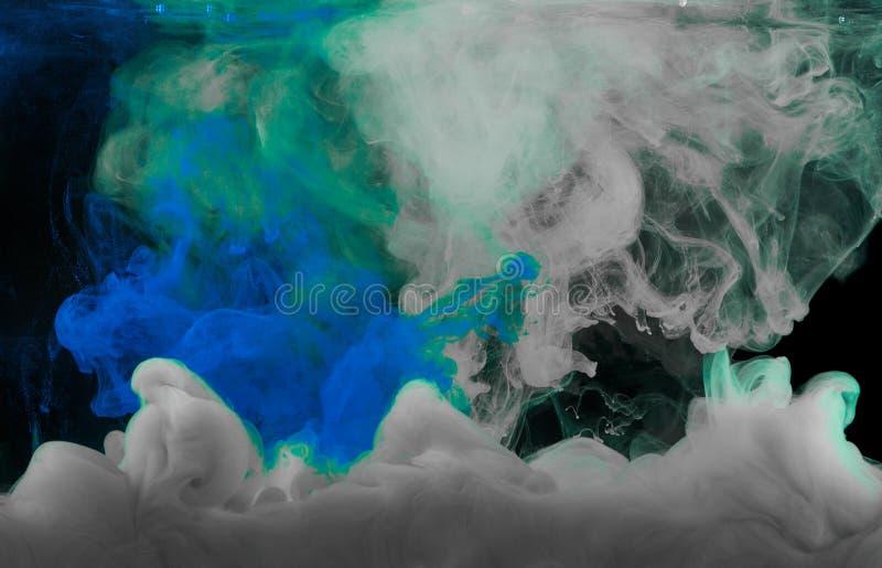 Éclaboussure d'encre de vert et blanche bleue photographie stock