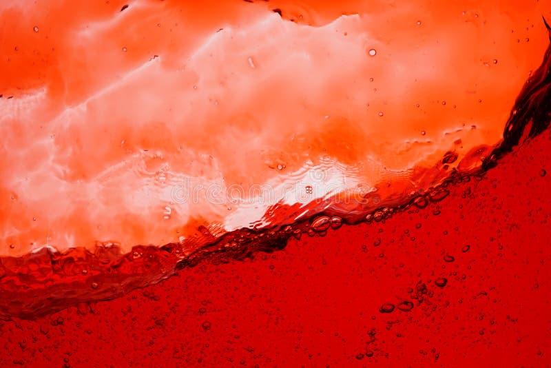 Éclaboussure de vin rouge - fermez-vous vers le haut du fond abstrait image stock