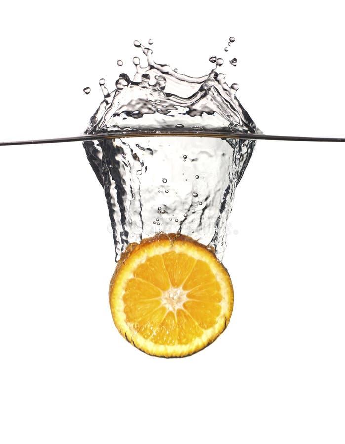 Éclaboussure orange dans l'eau image libre de droits