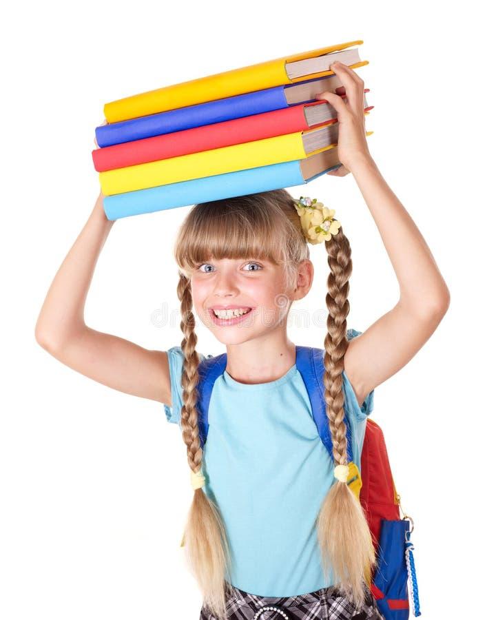 Écolière avec des livres de fixation de sac à dos. photo stock