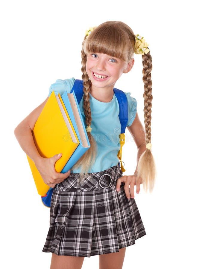 Écolière avec des livres de fixation de sac à dos. photos stock