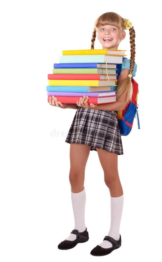 Écolière avec des livres de fixation de sac à dos. image stock