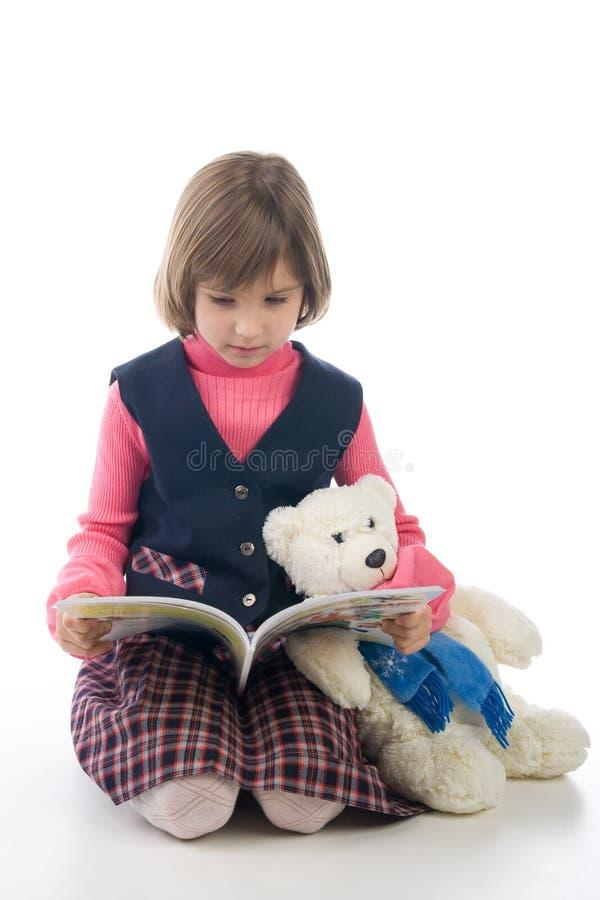 Écolière avec l'ours de livre et de nounours photo libre de droits