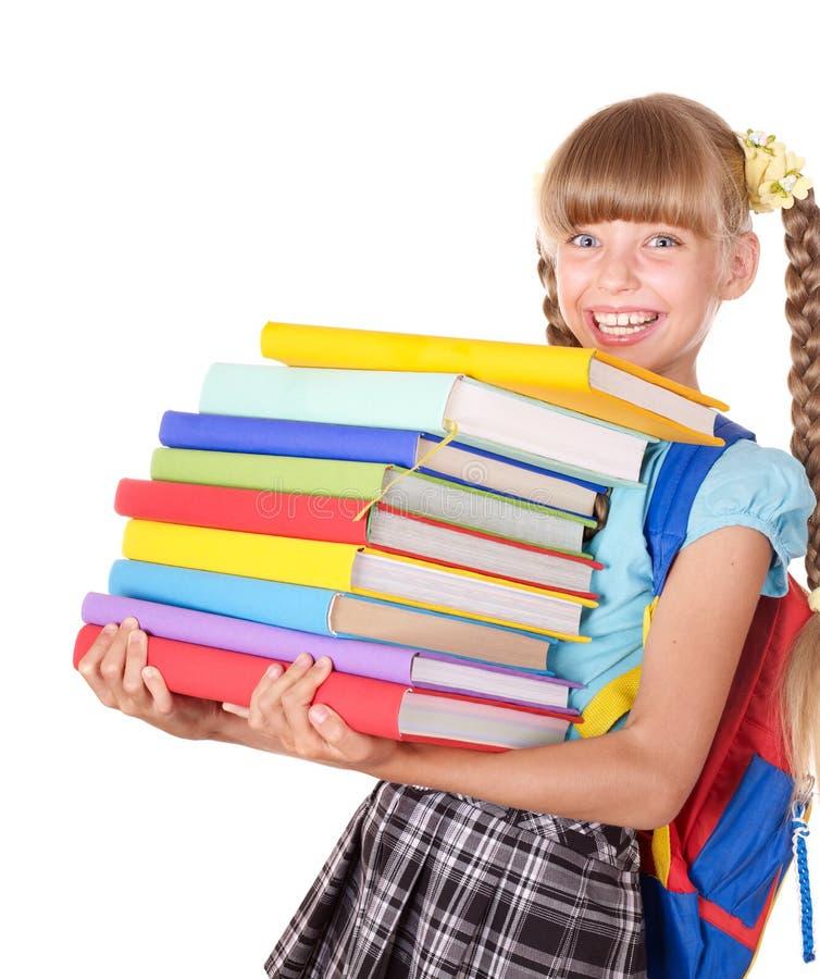 Écolière avec la pile de fixation de sac à dos des livres. photographie stock