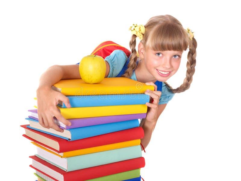 Écolière avec la pile de fixation de sac à dos des livres. image stock