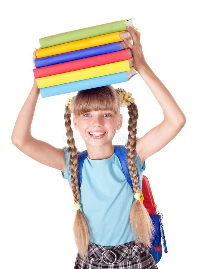 Écolière avec la pile de fixation de sac à dos des livres. photos libres de droits