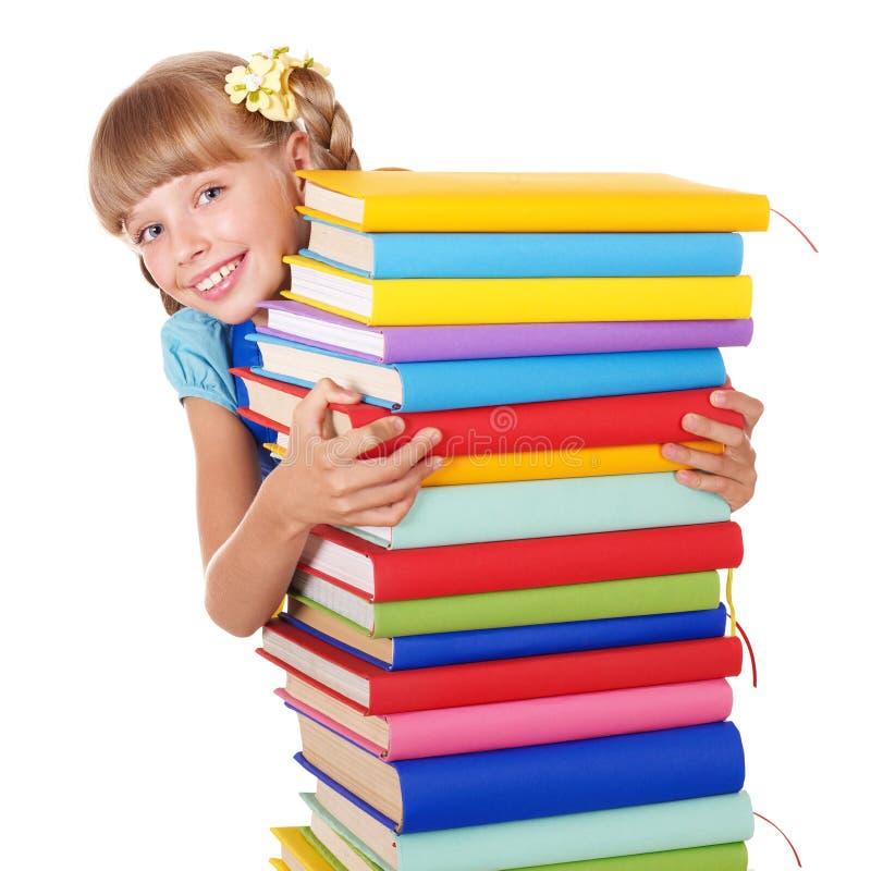 Écolière avec la pile de fixation de sac à dos des livres. image libre de droits
