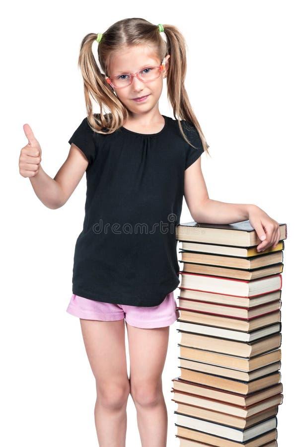 Écolière avec le pouce  images stock