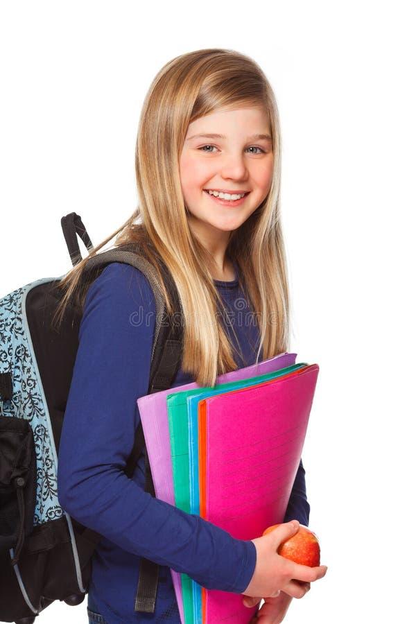 Écolière avec le sourire de dépliant photographie stock libre de droits