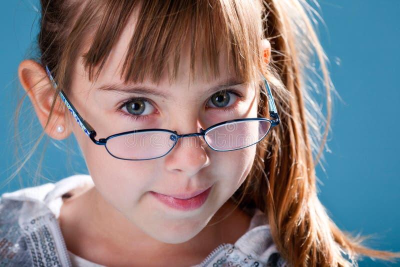 Écolière dans des lunettes photos stock