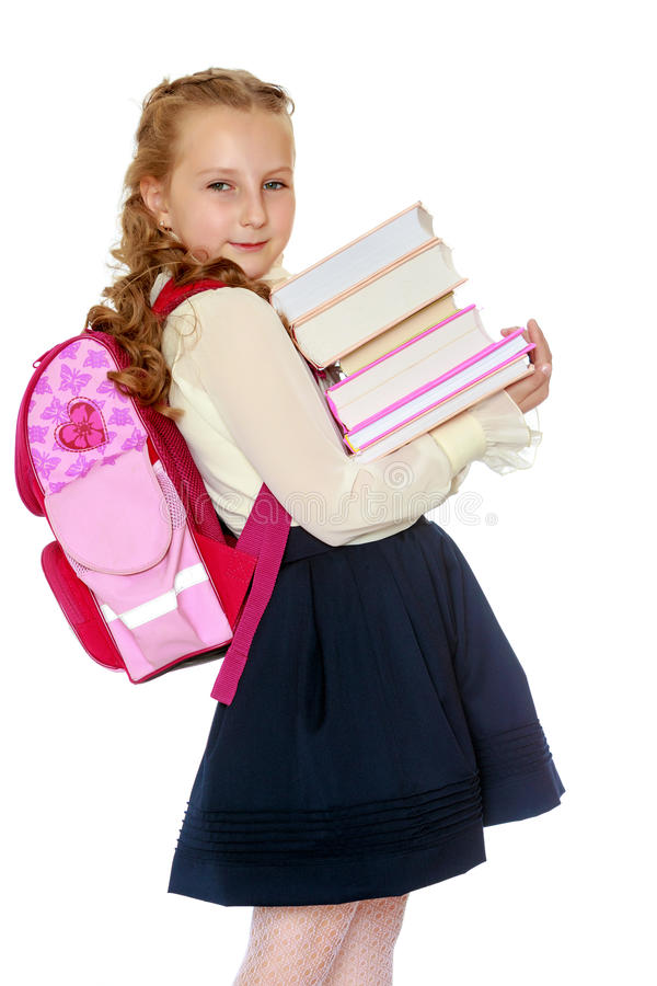 Écolière de fille avec une sacoche derrière des épaules et des livres en Han photographie stock libre de droits