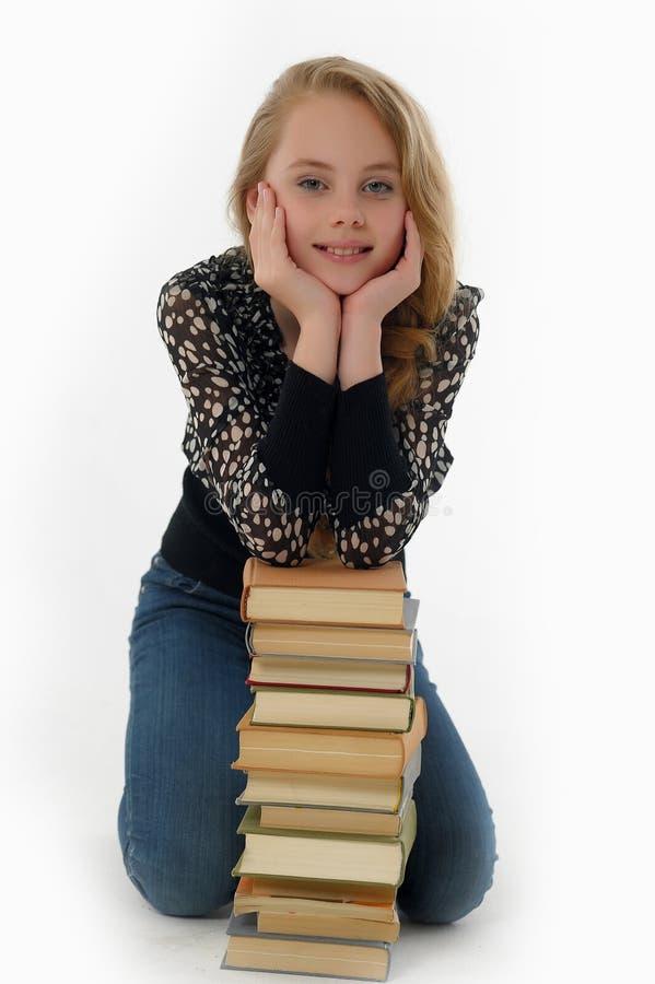 Écolière de sourire avec des livres photos libres de droits