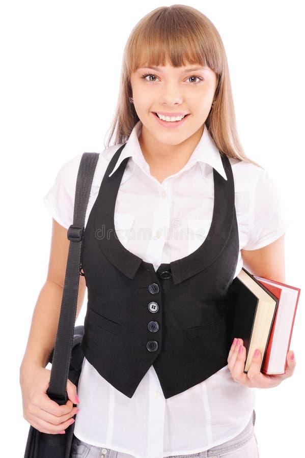 Écolière de sourire avec le portefeuille et les manuels image stock