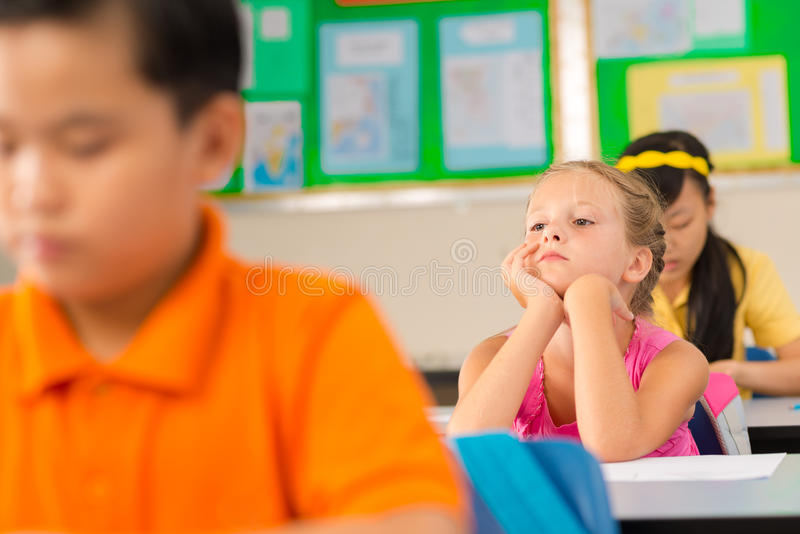Écolière ennuyée photos stock
