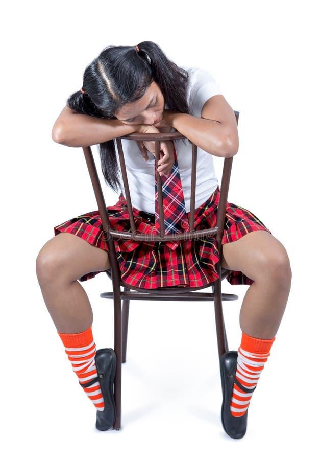 Écolière s'asseyant sur une chaise photographie stock libre de droits
