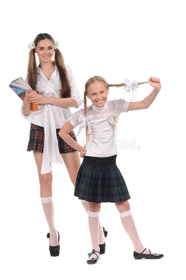 Écolières drôles avec des livres dans la main photo libre de droits