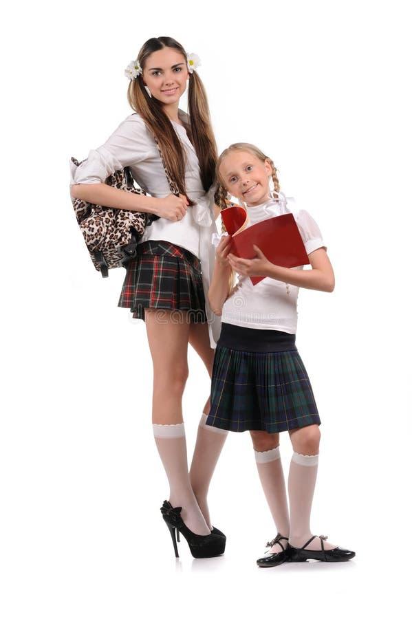 Écolières drôles avec des livres dans la main photographie stock