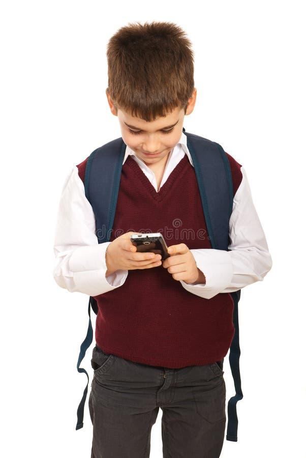 Écolier avec le mobile de téléphone image libre de droits