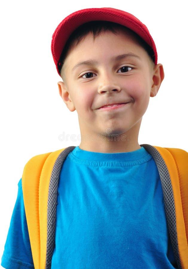 Écolier avec le sac à dos et un chapeau photo stock