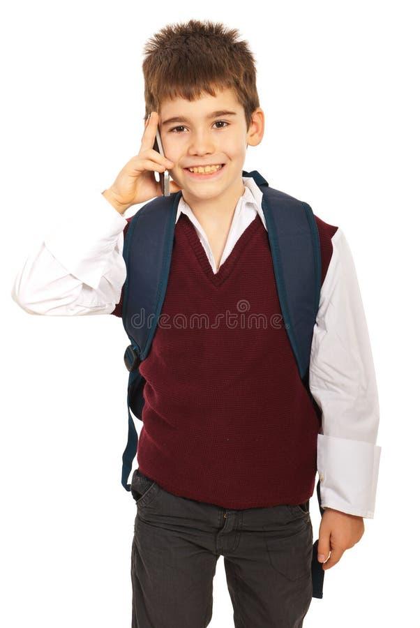 Écolier parlant par le mobile de téléphone photographie stock