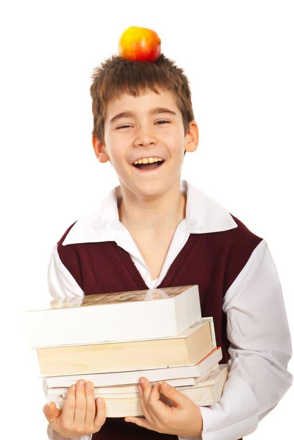 Écolier riant avec des livres photographie stock