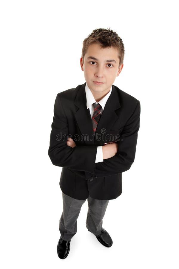 Écolier secondaire sérieux dans l'uniforme photo libre de droits