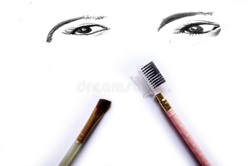 Économe de maquillage d'oeil d'isolement sur le blanc photo libre de droits