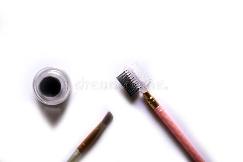 Économe de maquillage d'oeil d'isolement sur le blanc photos libres de droits