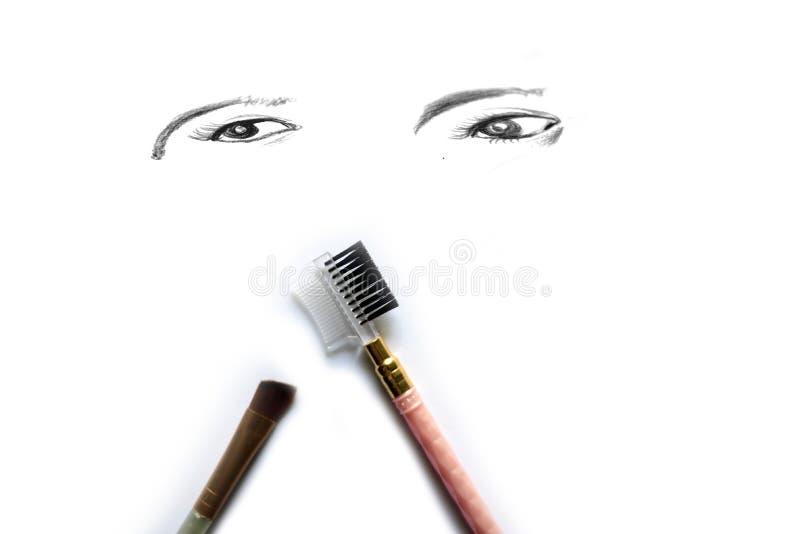 Économe de maquillage d'oeil d'isolement sur le blanc photos stock