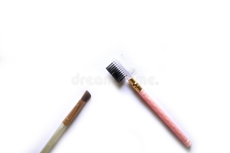 Économe de maquillage d'oeil d'isolement sur le blanc image stock