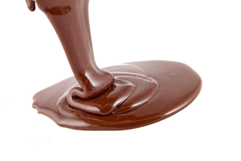 Écoulement de chocolat d'isolement photographie stock