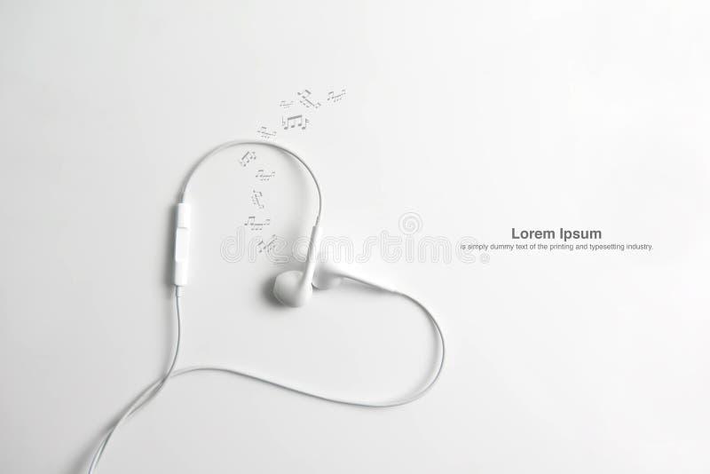 Écouteur dans la forme du coeur Sur le fond blanc images libres de droits