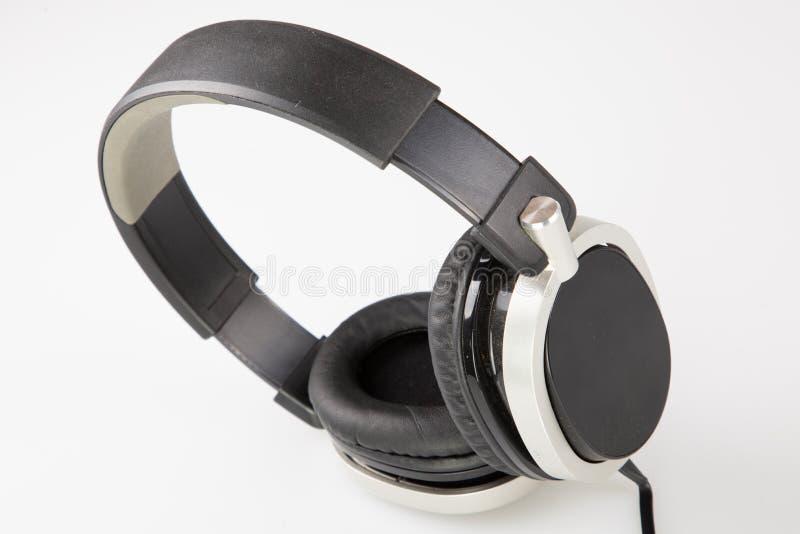 Écouteur moderne noir sur le backgound gris photographie stock libre de droits