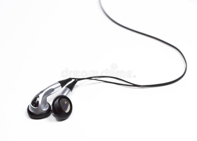 Écouteurs argentés de bourgeon d'oreille photographie stock