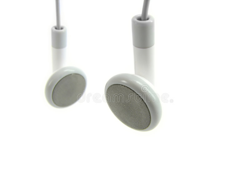 Écouteurs blancs. image stock