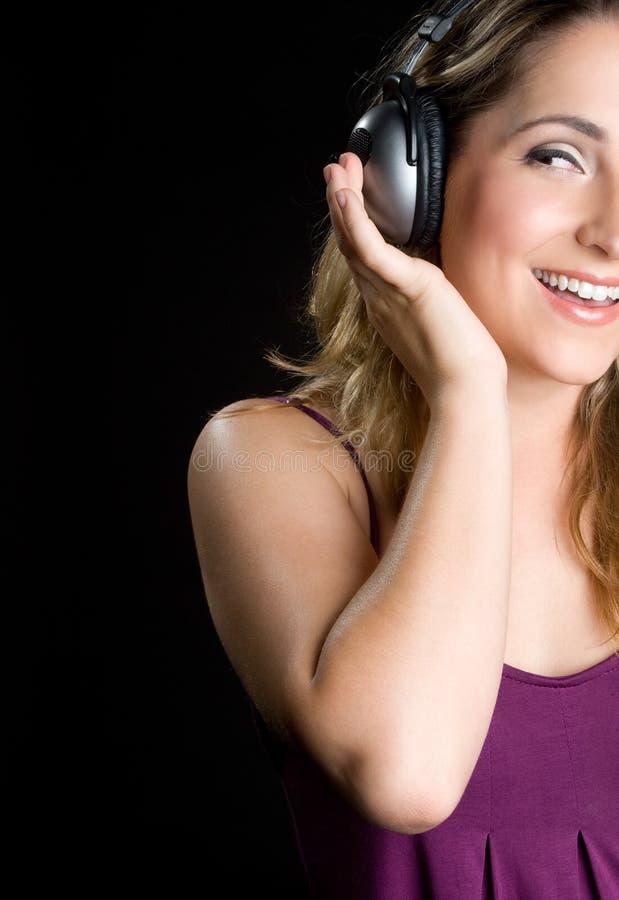 écouteurs blonds de fille photos stock