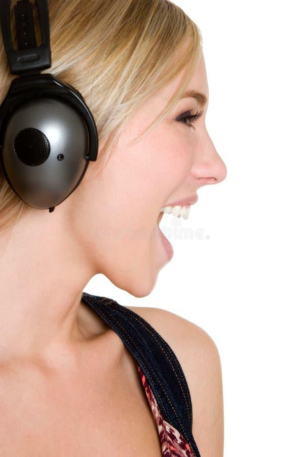 écouteurs de fille de l'adolescence images libres de droits