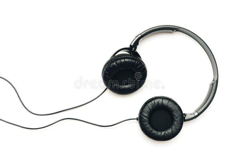 écouteurs de fond blancs image libre de droits