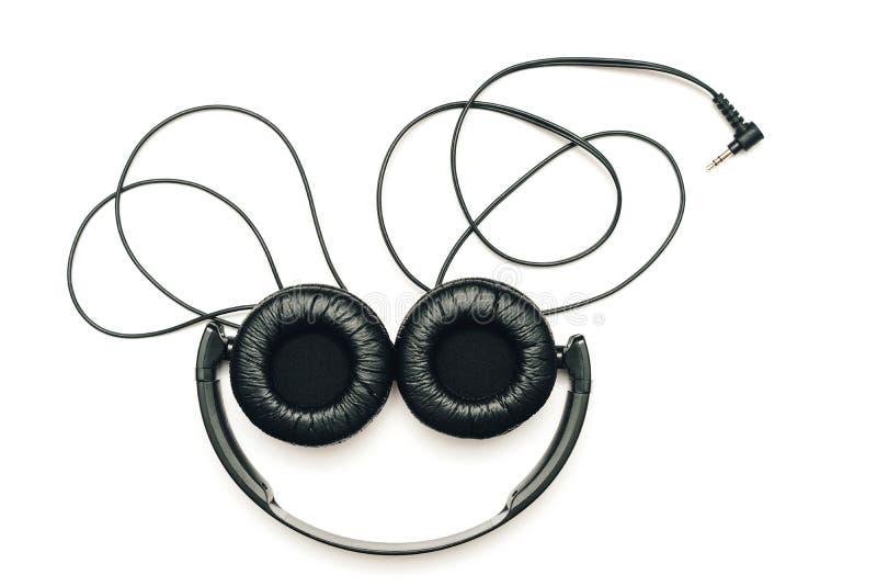 écouteurs de fond blancs photographie stock libre de droits