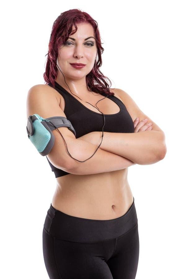 Écouteurs de port et lecteur mp3 de femme de forme physique photos stock