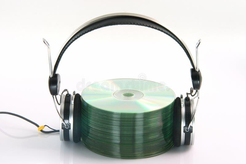 Écouteurs et Cd photographie stock